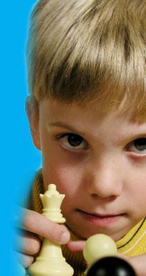 4 Chess Playing Boy